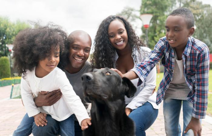 Happy family adopting a dog