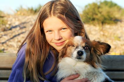 Girl and Papillon Dog