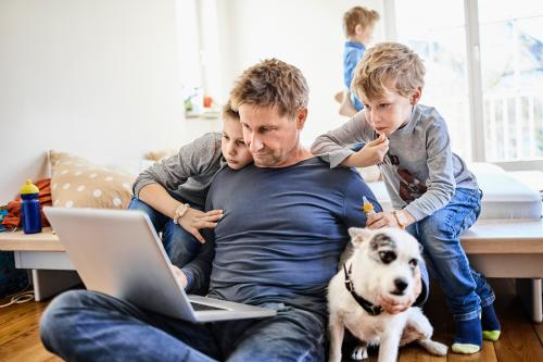 Father and sons with dog