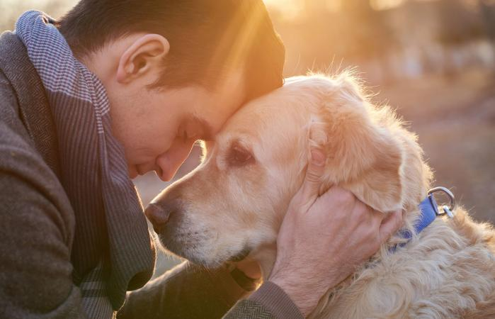 Man embracing his faithful friend the dog