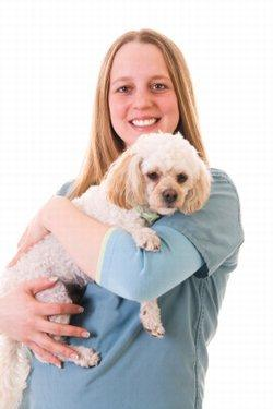 Woman holding her Poodle
