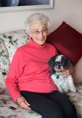 Senior woman sitting with her Shih Tzu