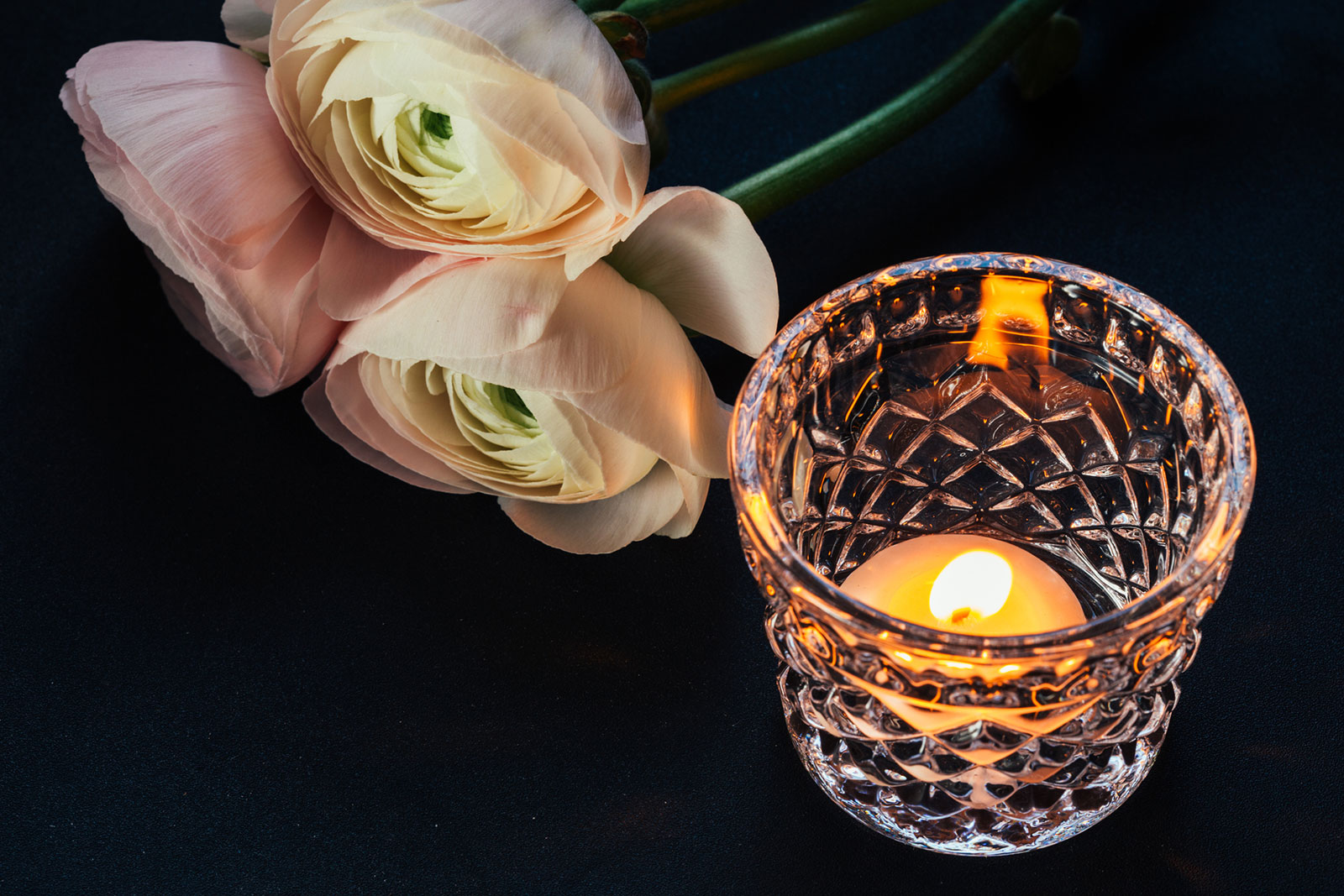 three-ranunculus-with-candle.jpg