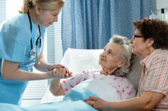 Hospice nurse with patient and family member