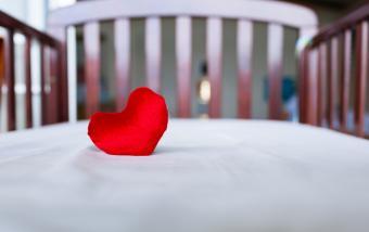 Heart in baby's crib