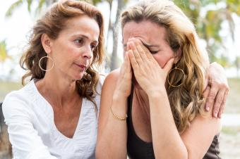 comforting grieving woman