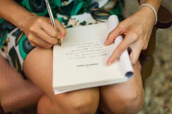 Woman writing notes for obituary