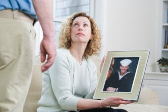 Woman holding picture of military son