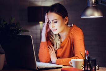 Sad woman writing on laptop