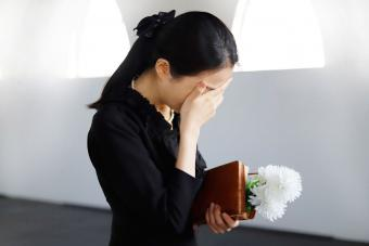 Grieving woman mourning at funeral