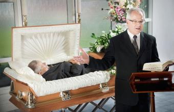 A Minister Conducting A Funeral Service