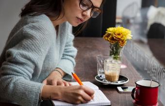 Woman at cafe writing