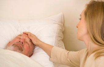 woman taking care of dying father