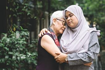 women comforting one another