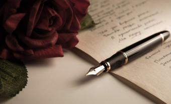 Fountain pen and roses with poetry