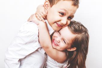 Girl hugging big brother