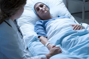 dying woman in hospice with nurse