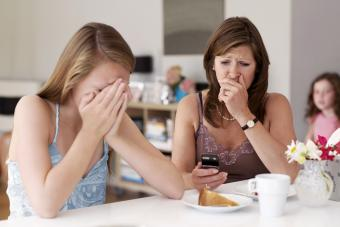 Upset mother and daughter with phone