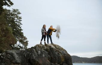 Mother and daughter spreading ashes