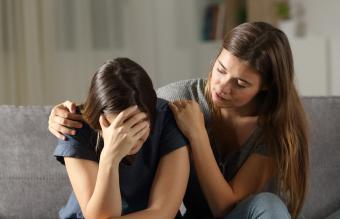 Teen comforting sad friend
