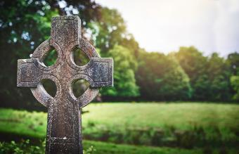 Celtic cross gravestone in a cemetery