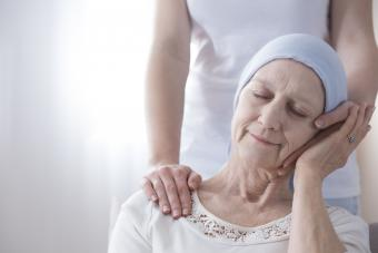 Loved one comforting hospice family member