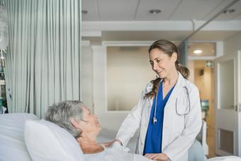 Doctor consulting with patient in hospital