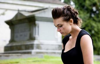 Woman Mourning at Graveyard