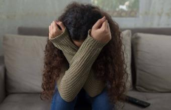 Grieving girl on sofa