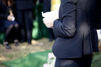 Woman reading eulogy at a funeral