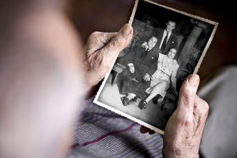 Old man looking at a photograph