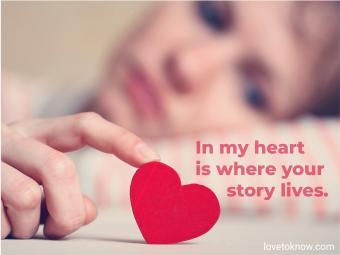 Woman touching little red heart
