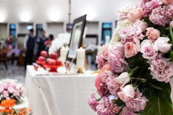 Memorial service with pink flowers in the church