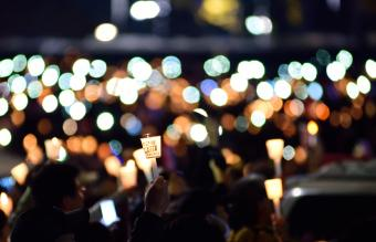 People With Candles Marching