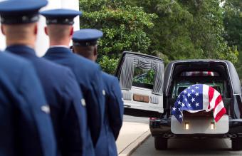 officers watching casket