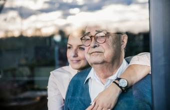 woman embracing senior man