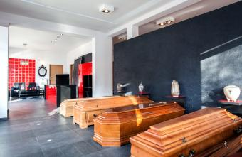 Coffins and urns in a funeral office