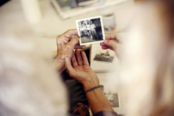 Women looking at family photographs