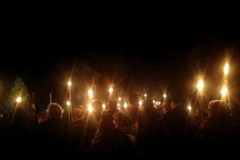 Gathering of people with torches