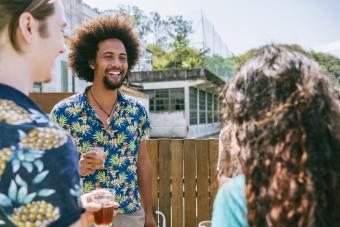 Man wearing Hawaiian Shirt celebration of life outdoor party