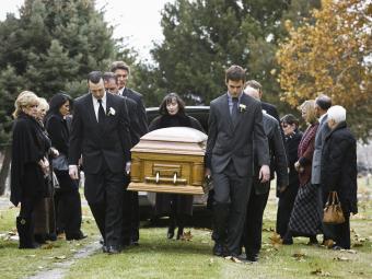 Pallbearers carrying casket