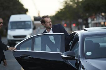 Male friend opening car door