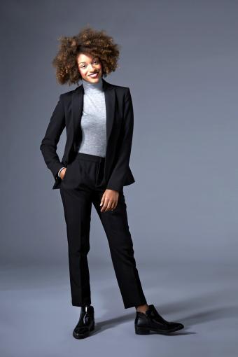 Woman wearing a black power suit