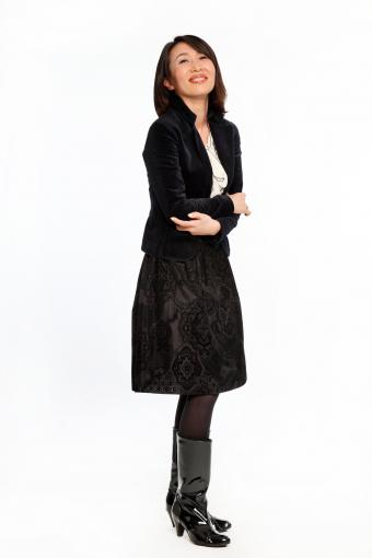 Japanese woman wearing all black and tall boots