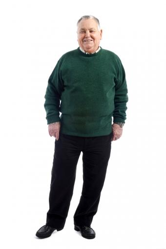 Senior man wearing slacks and a sweater
