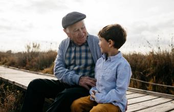Happy grandfather sitting with his grandson