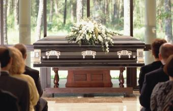 closed casket with flowers