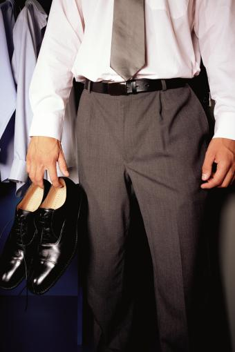 Man dressed in pants, shirt and tie