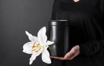Woman with mortuary urn