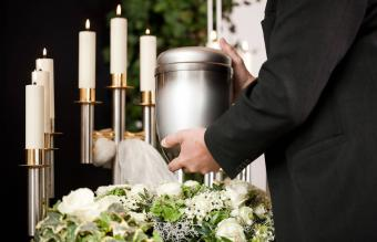 mortician on funeral with urn